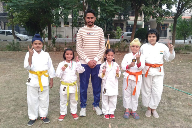 Karatekas win 4 medals in state-level c'ships