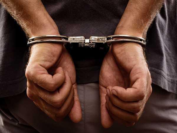 Man held with 1-kg heroin