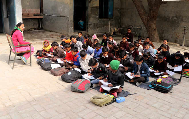 Braving cold, students attend classes in open