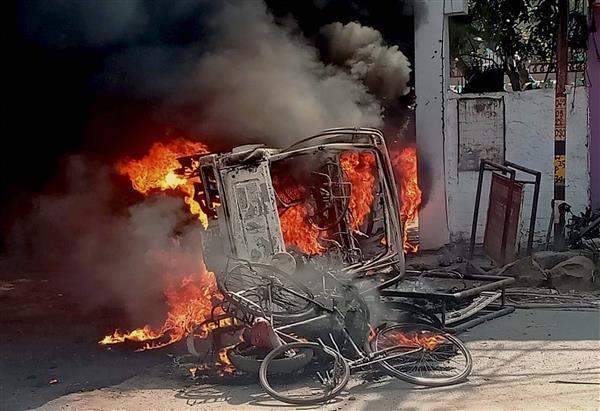 Violent protesters target police over Munger firing; EC removes SP, DM
