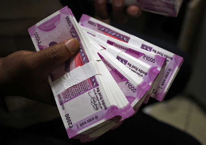 Rupee ends 7 paise lower against US dollar