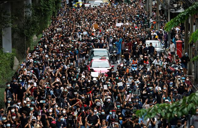 Tens of thousands protest across Thailand in defiance of ban