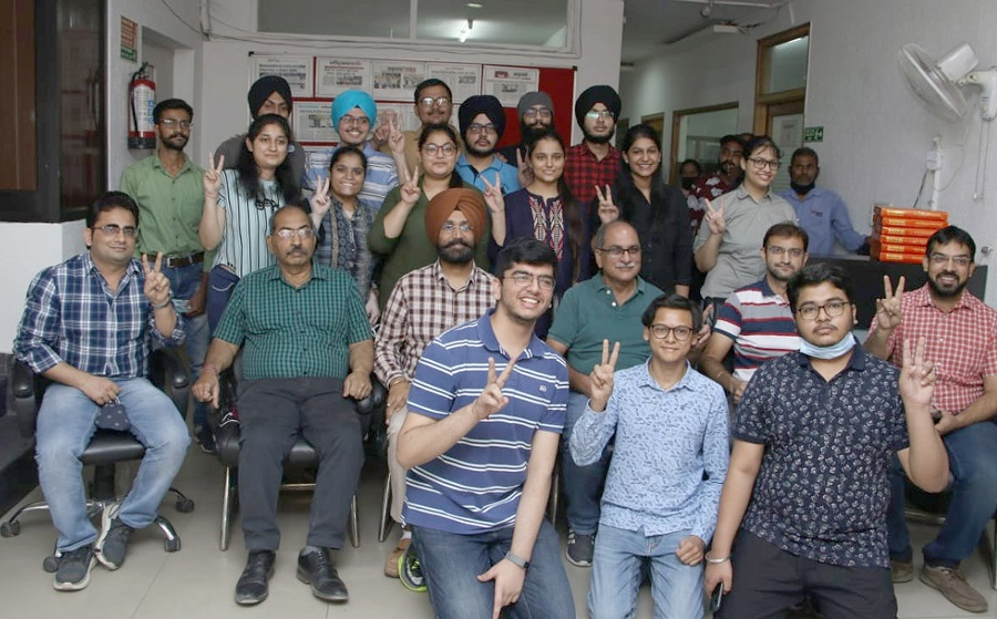 NEET toppers celebrate success with families
