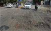 Riddled with potholes, this stretch lacks streetlights too