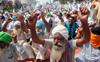 Farm unions stagedharnasat toll plazas, block railway tracks in Bathinda