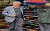 British PM's father pictured in shop without face mask, apologises