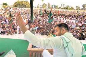 Wooing Bihar's voters with free vaccine, jobs