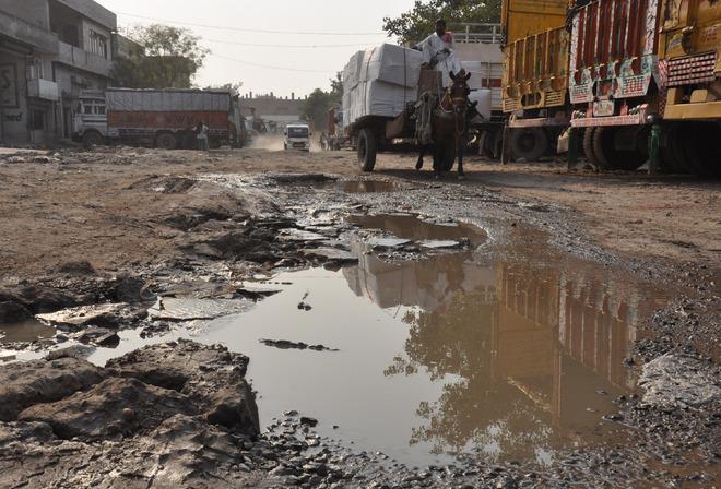Potholed roads a bane for Transport Nagar