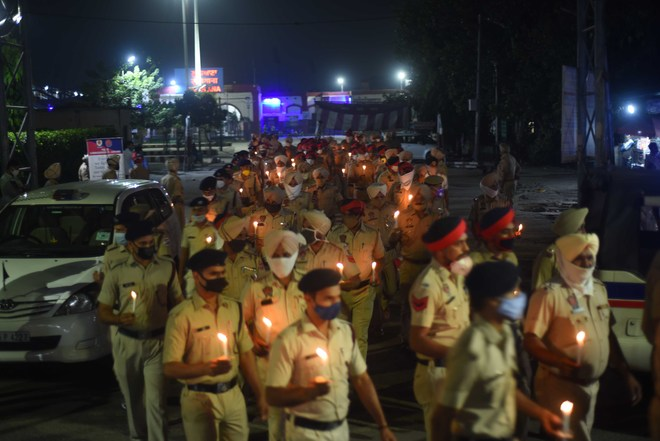 Candle march by cops in memory of martyrs