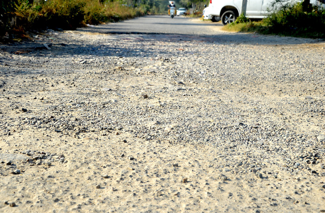 Potholed Sua Road gives bumpy ride to commuters