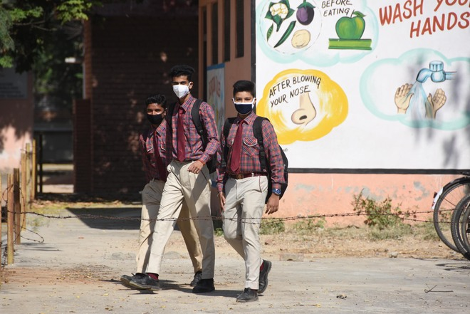 Government schools open,  but with 12 pc attendance