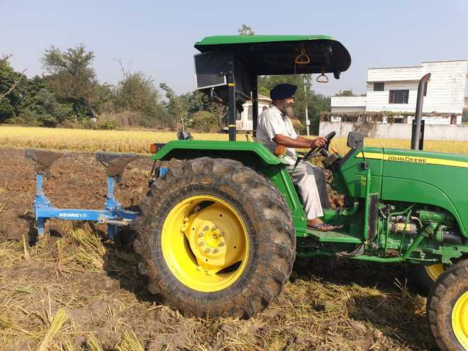 A progressive farmer who gave up stubble burning eight years ago