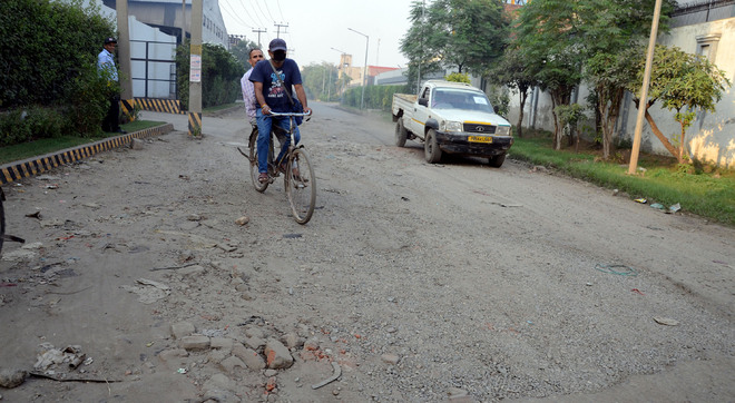 It's a bumpy ride on potholed roads in Focal Point area