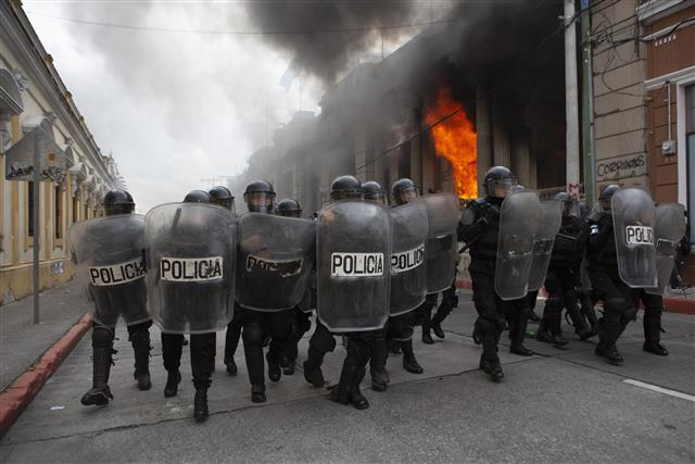 Protesters set fire to Guatemala's Congress in protests over 2021 budget