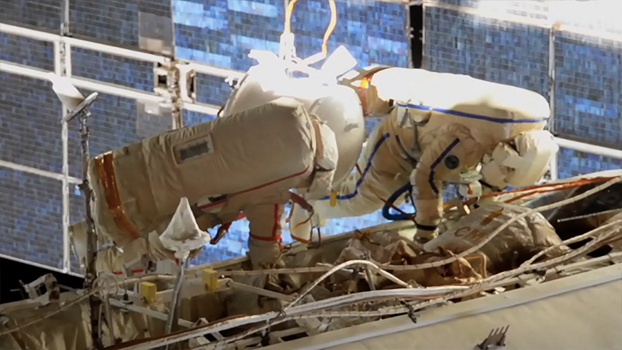Russian spacewalk prepares space station for new module