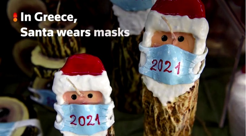 Santa candles get masked up in Greece in COVID-19 surge