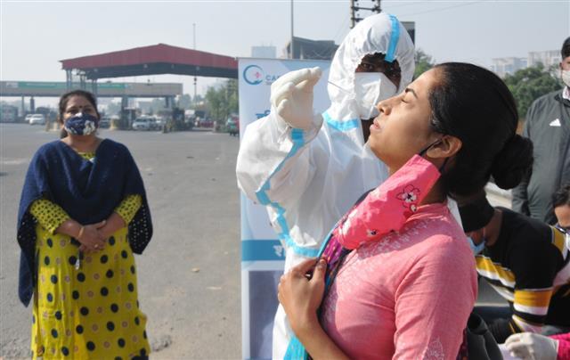 Delhi commuters made to undergo corona test at Gurugram toll plaza