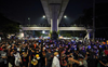 Thai protesters march to barracks against king's military power