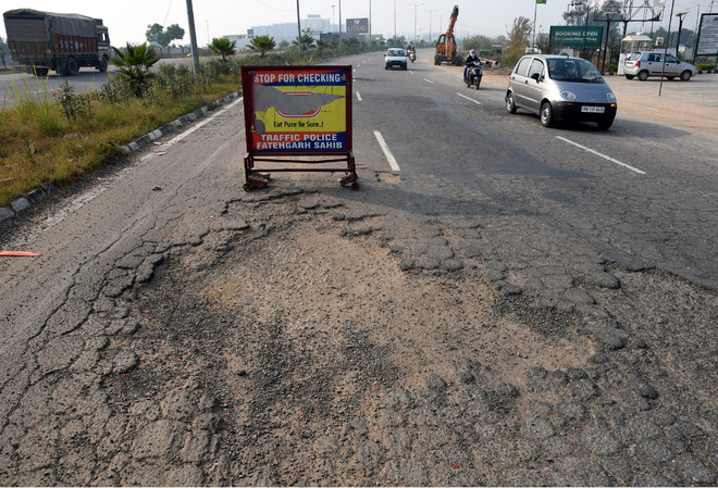 Drive with caution on this potholed road in Zirakpur