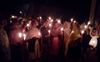 Residents hold candle march in support of farmers' protest