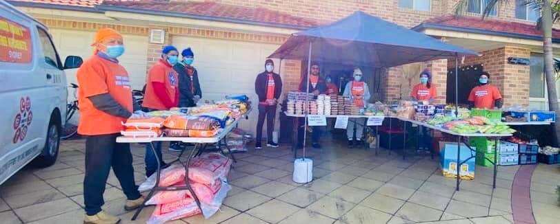 Sikhs prepare meals for 300 Australians who returned from New Delhi; story in pictures