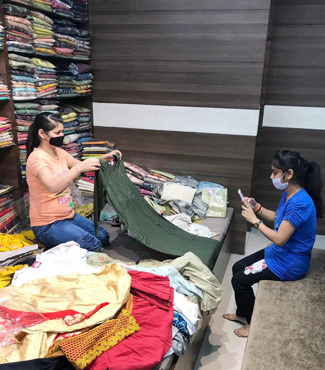 Adapting to new normal, garment traders switch to online sale