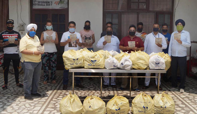 YFC volunteers, ITI students stitch, distribute 6K masks
