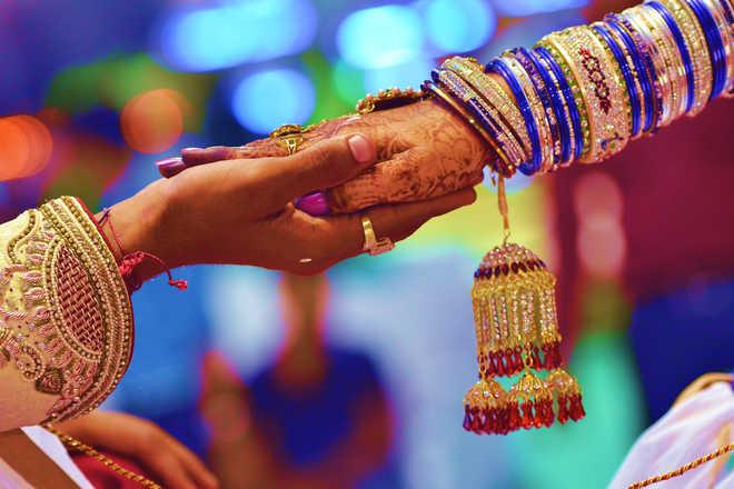 Virus shrinks big fat weddings, many hit hard