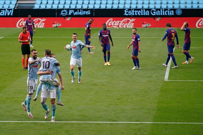 Aspas strikes late to blunt Barca's title bid