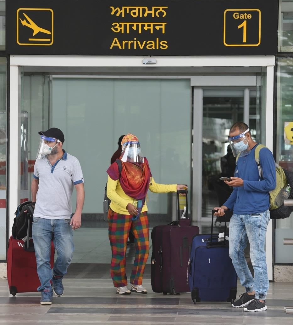 Two flights carrying 324 passengers from Auckland and Kuwait arrive at Chandigarh International Airport