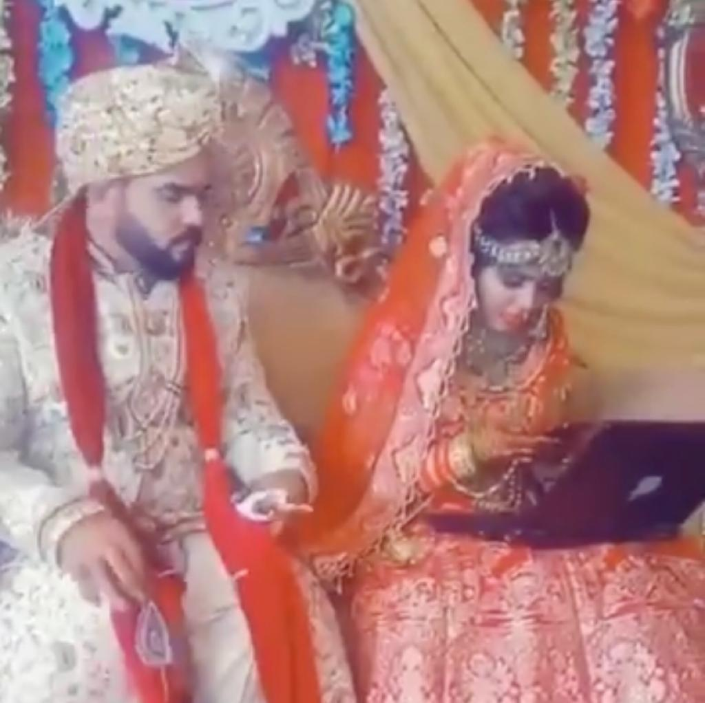 Caught on camera: A bride, glued to her laptop and phone, ignores her groom at the wedding