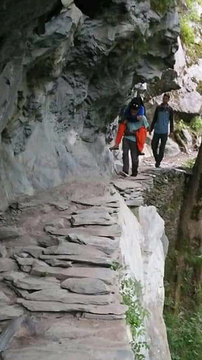 Kin carry ailing woman on their backs in remote Chamba district