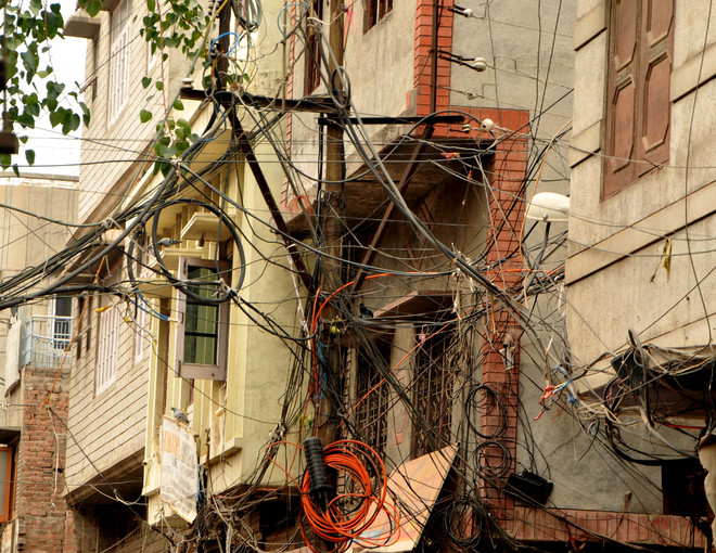 Cobwebs of electricity wires an eyesore for residents, trouble for electricians