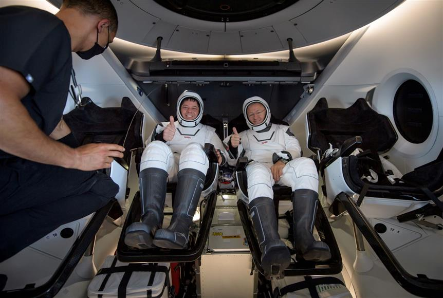 SpaceX brings NASA crew back to earth in first splashdown in 45 years
