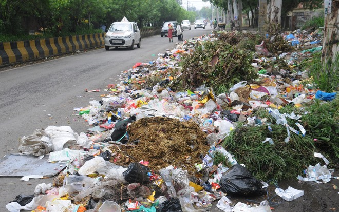 Once home to fuel station, Ladowali road turns into garbage dump