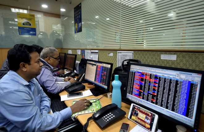 Sensex, Nifty tick higher on global cues; banking, finance stocks in demand