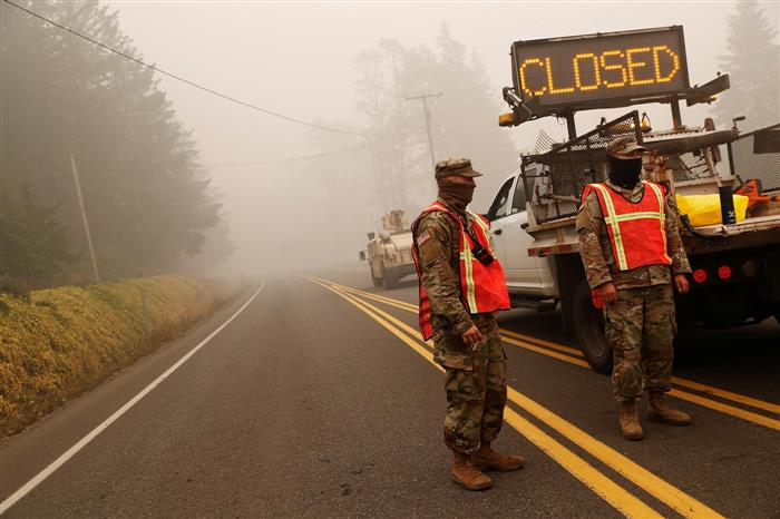 Thousands of Oregon evacuees shelter from wildfires as US disaster declared