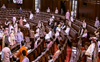 Lok Sabha adjourned for an hour as MPs sit in dharna in Rajya Sabha blocking seats
